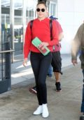 Gal Gadot in a red sweater arrives back at JFK Airport in New York
