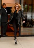 Gigi Hadid in a black leather jacket leaves her apartment to take walk around SoHo in New York City