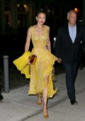 Gigi Hadid in a yellow dress returns to her apartments after a night out in New York
