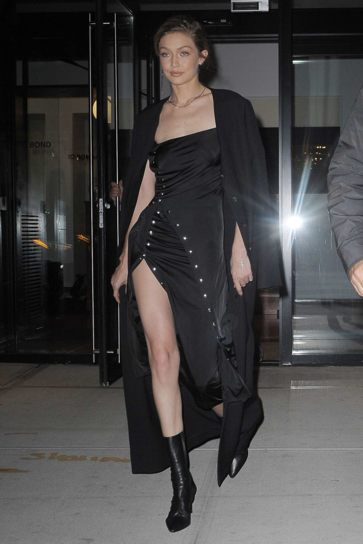 Gigi Hadid in an all black ensemble leaves her apartment in New York City