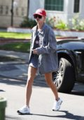 Hailey Baldwin wearing an oversize jacket and shirt while she grabs a smoothie from Earth Bar with friends in Los Angeles