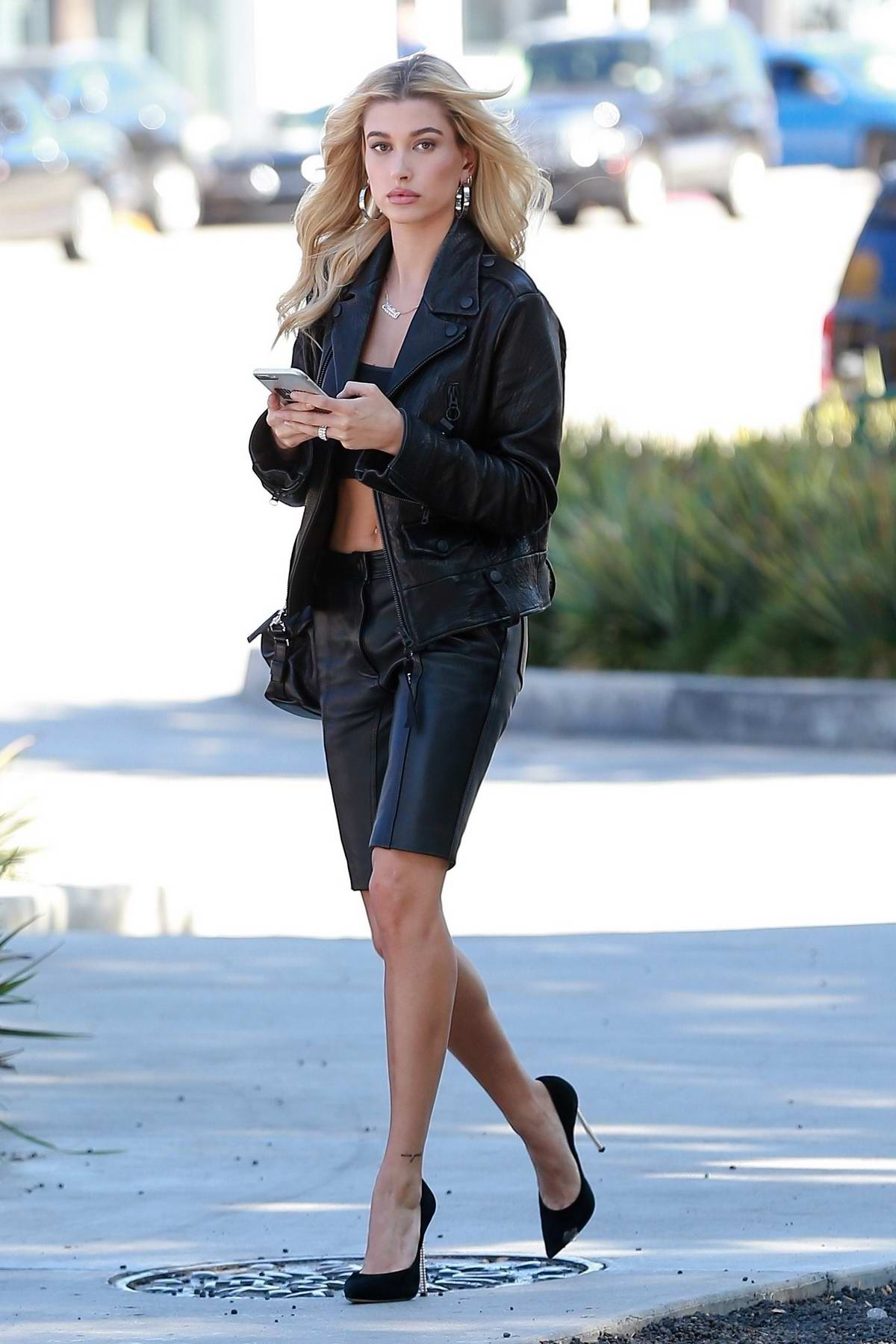 Hailey Baldwin wearing leather bermuda shorts with leather jacket while out for lunch in Beverly Hills, Los Angeles