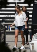 Hannah Davis wears white shirt with denim shorts while looking for houses in Miami, Florida