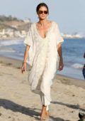 Heidi Klum in a white dress spotted at the beach in Malibu, California