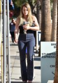 Hilary Duff in a black top with a striped pants grabs an iced coffee in Studio City, Los Angeles