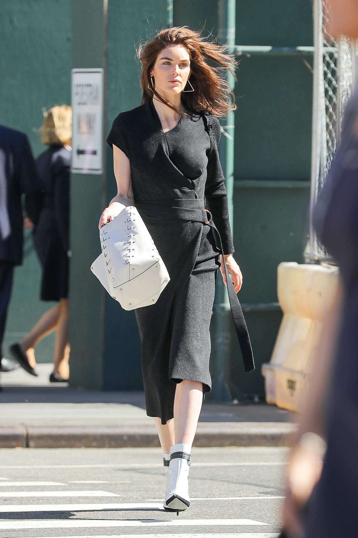 Hilary Rhoda wearing a stylish black dress during a photoshoot in New York City