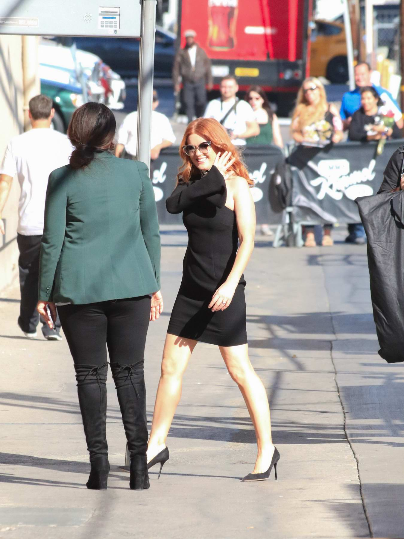 Isla Fisher wearing a black mini dress is spotted arriving at Jimmy Kimmel Live in Los Angeles