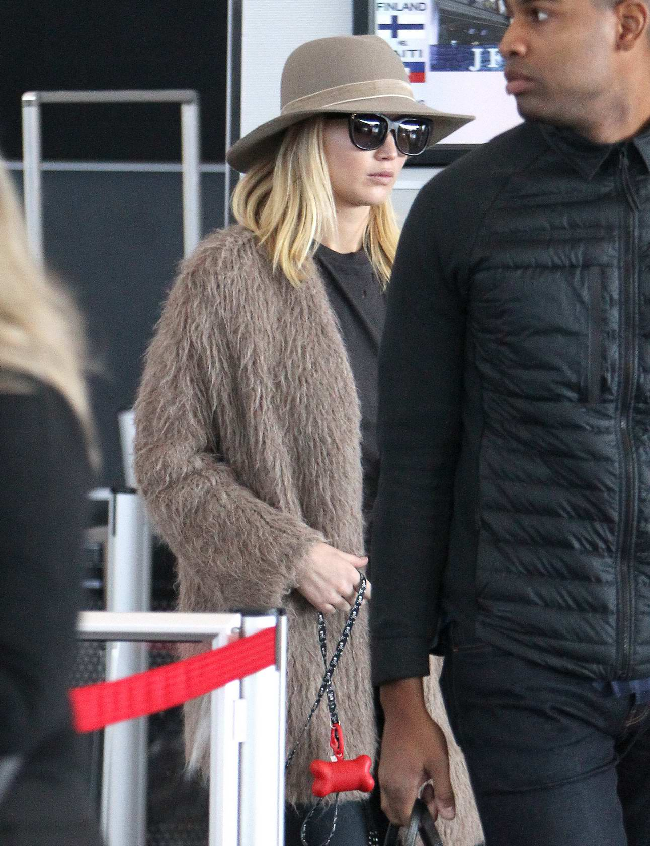 Jennifer Lawrence is spotted with dog departing from JFK Airport in New York City