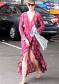 Jesinta Campbell stops by at a gas station in a stylish red dress in Sydney, Australia