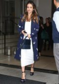 Jessica Alba wears blue coat over a white dress while she leaves her hotel in New York City