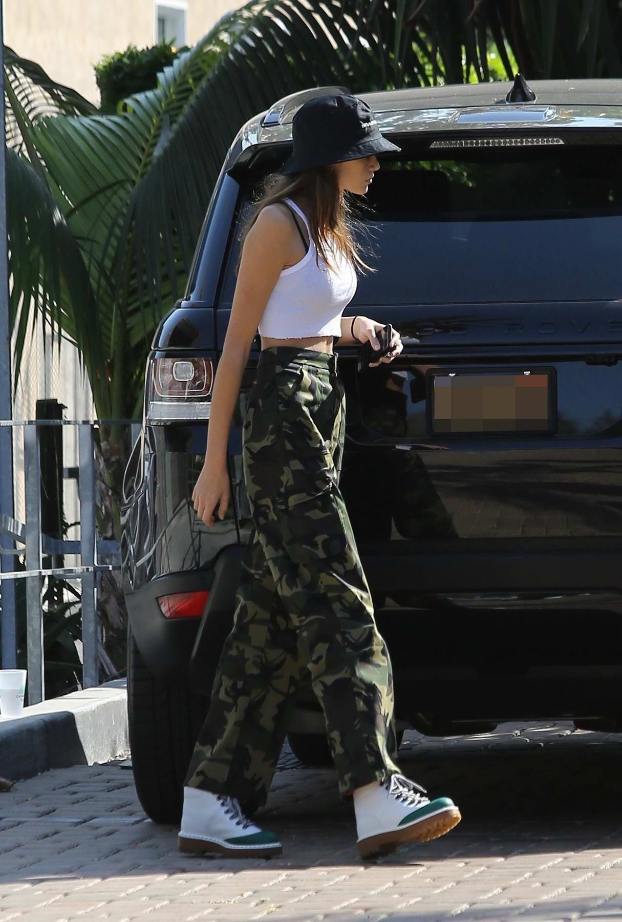 15fd506a2d5ef kaia gerber in white tank top and camo pants grabs some lunch at sunlife  organic juice shop in malibu-091017_3