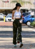 Kaia Gerber in white tank top and camo pants grabs some lunch at Sunlife Organic Juice Shop in Malibu, California