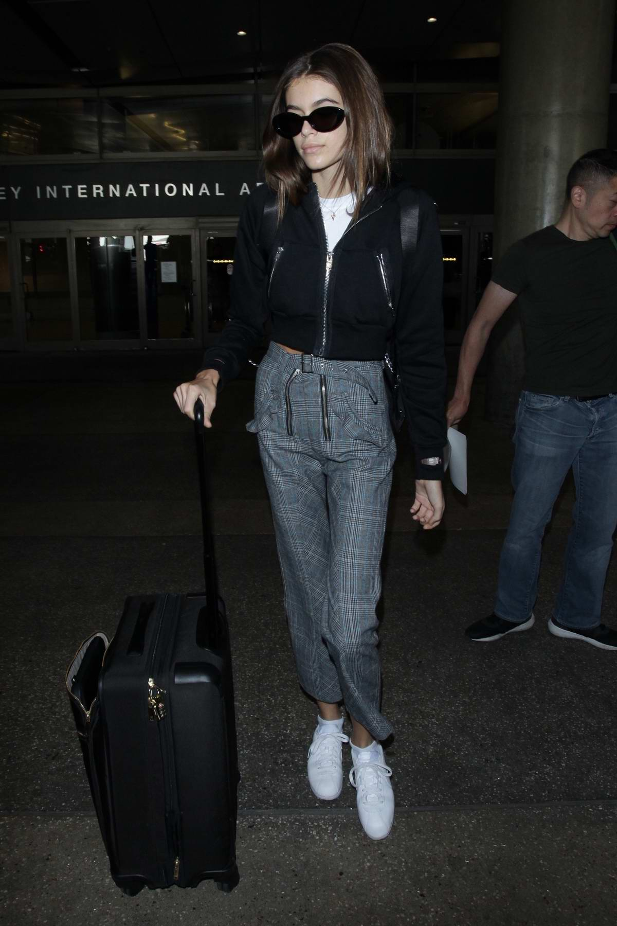 Kaia Gerber returns to Los Angeles after attending Paris Fashion Week
