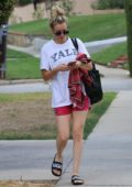 Kaley Cuoco in a white tee and red shorts leaving a yoga class in Studio City, Los Angeles