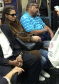 Katie Holmes shops at A.P.C. and rides a crowded subway R train in Manhattan's SoHo neighborhood, New York City
