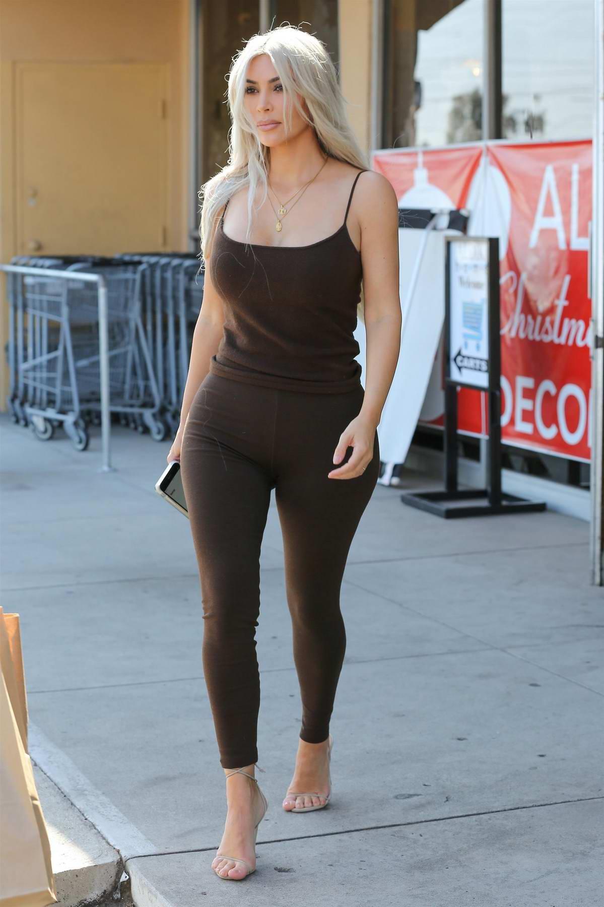 Kim Kardashian and Kourtney Kardashian are seen leaving the Aldik Home Store in Van Nuys, California