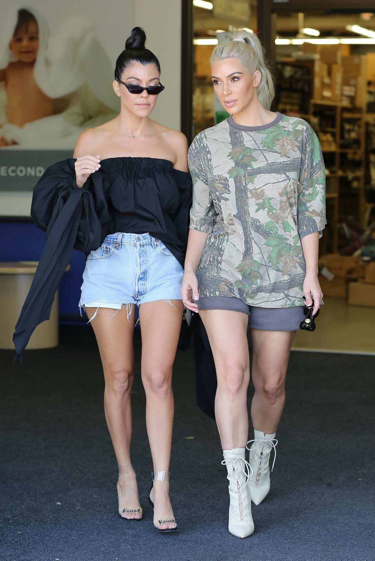 Kim Kardashian and Kourtney Kardashian go shopping at BuyBuy Baby in Calabasas, California