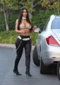 Kim Kardashian in bikini top and leather pants out in Beverly Hills, Los Angeles