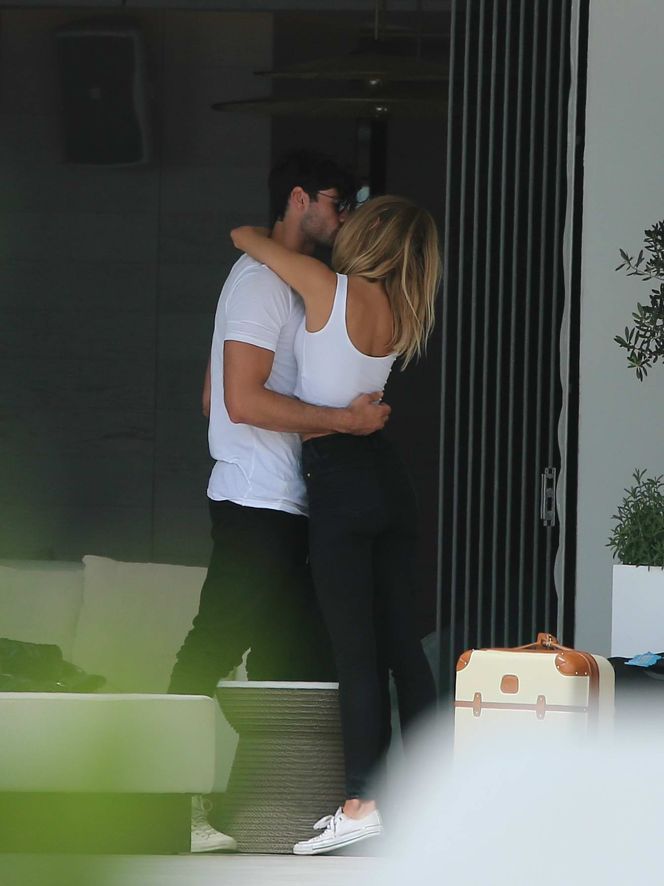 Kimberley Garner gets cosy with a Mystery man on holiday in Ibiza, Spain