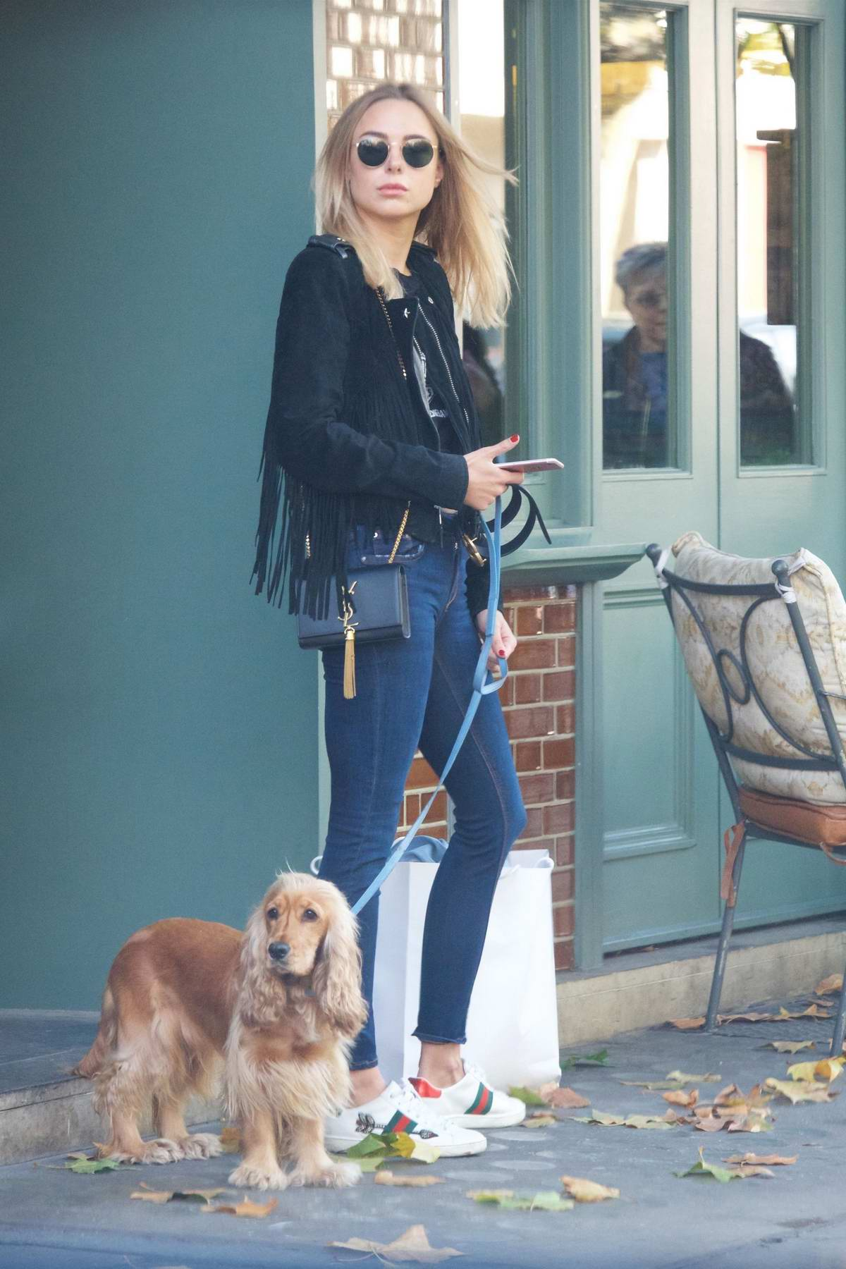 Kimberley Garner walking her dog out in London