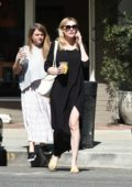Kirsten Dunst in a black maxi dress enjoys a latte while out in Los Angeles