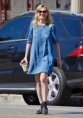 Kirsten Dunst in a blue denim dress out on a coffee run in Studio City, Los Angeles