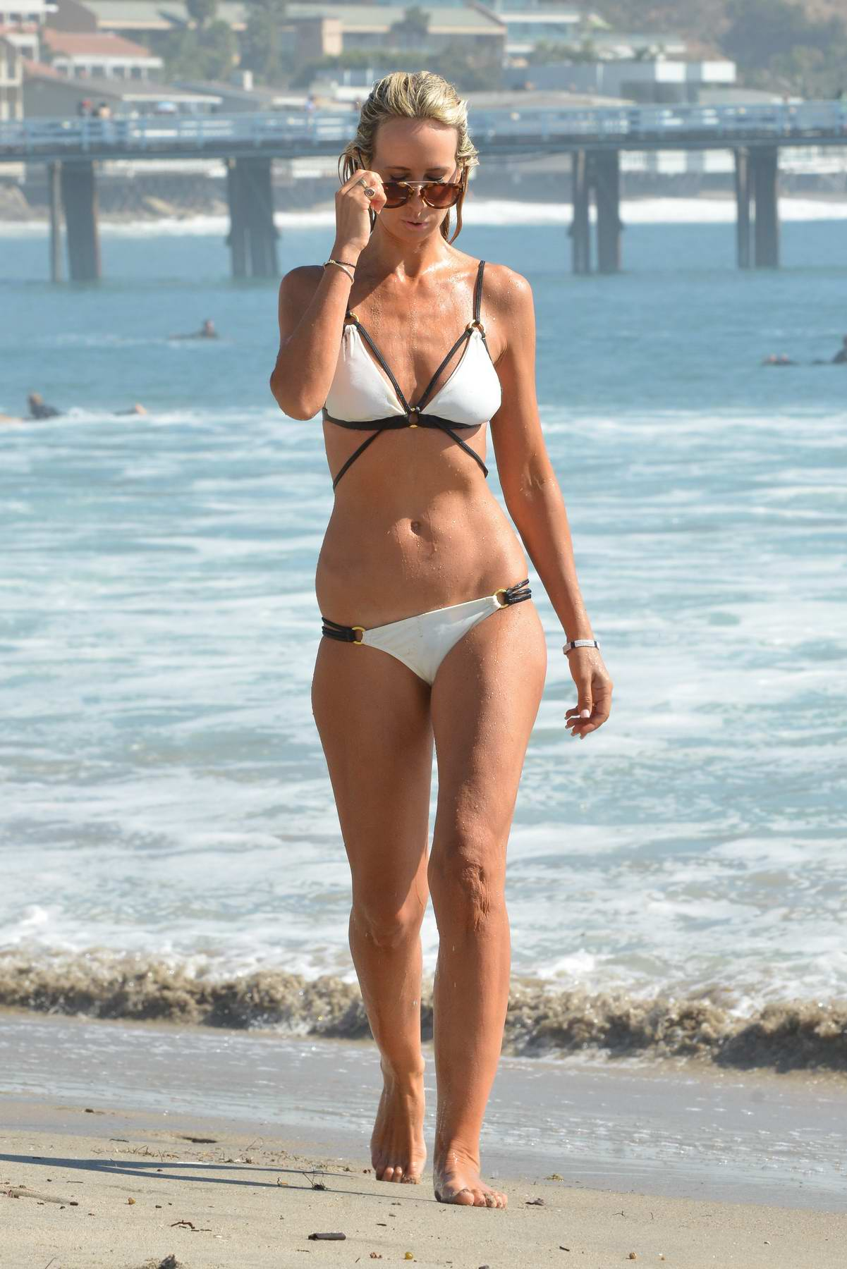 Lady Victoria Hervey in a white bikini enjoying her birthday weekend on the beach in Malibu, California
