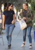 Lana Del Rey in a blue T-shirt and Jeans out for a walk with a friend in Hollywood, Los Angeles