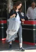 Lily Collins picks up her dry cleaning in West Hollywood, Los Angeles