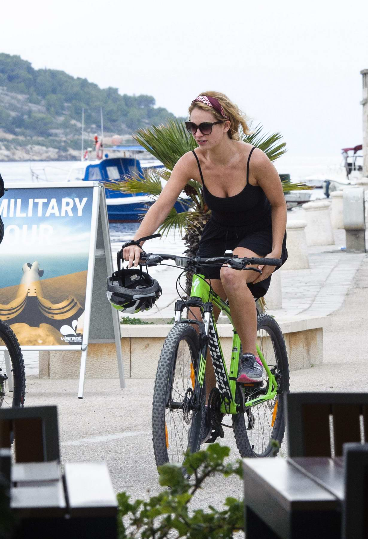 Lily James and Matt Smith riding bikes together around the Island of Vis in Croatia