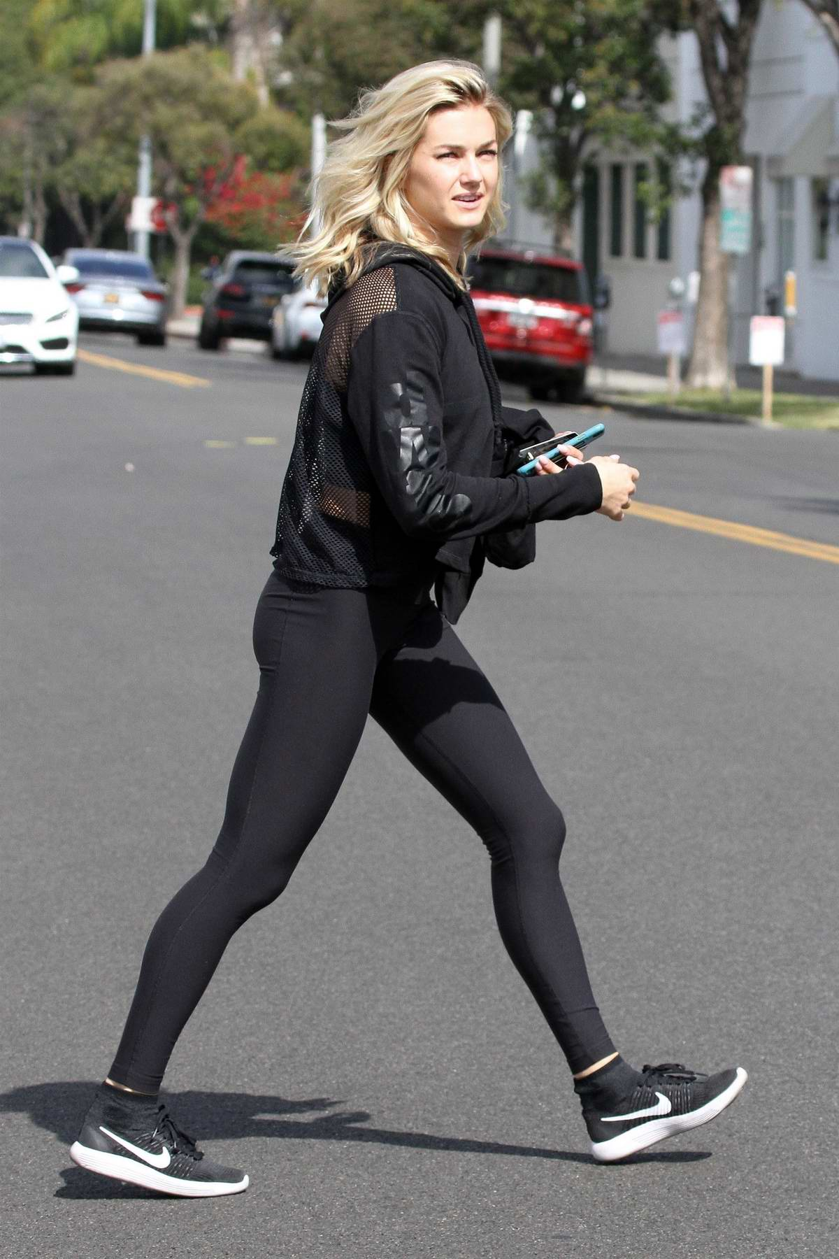 Lindsay Arnold has some trouble at the parking meter ahead of dance practice in Los Angeles
