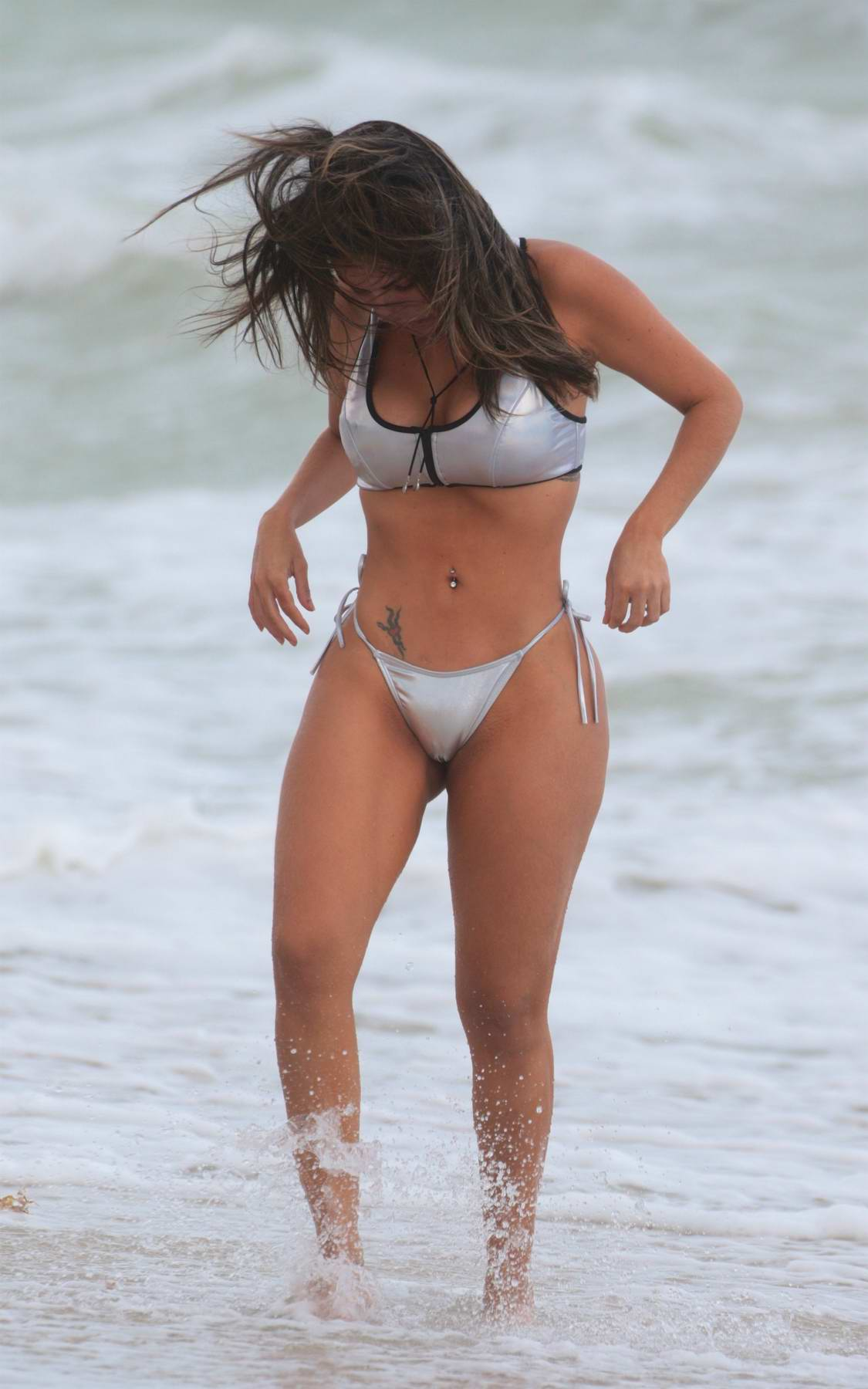 Liziane Gutierrez in a silver bikini at the beach in Miami
