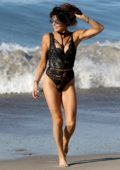 Lizzie Cundy hits the beach in a black swimsuit in Santa Monica, California