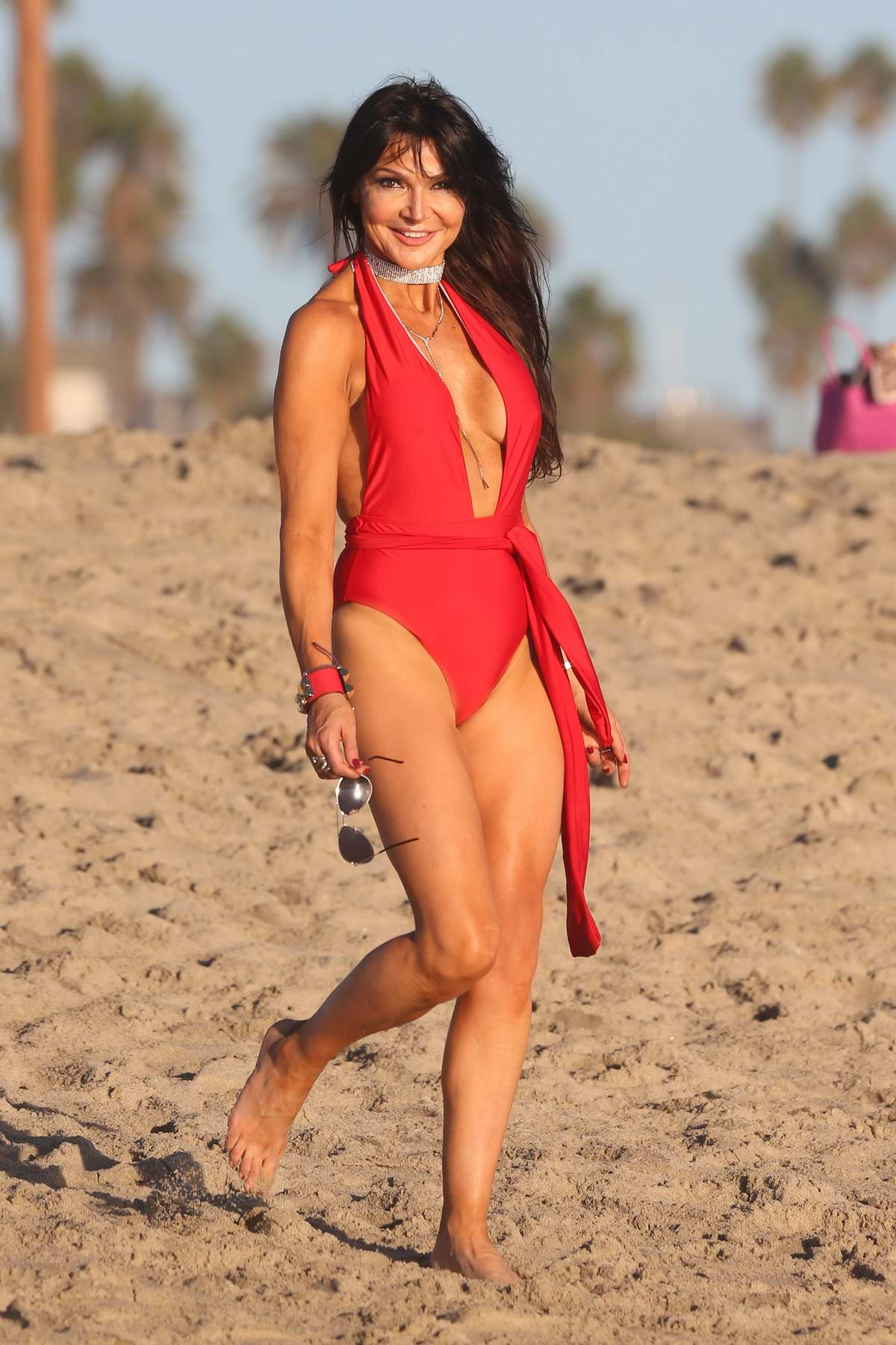 Lizzie Cundy in a red swimsuit enjoying the beach in Los Angeles