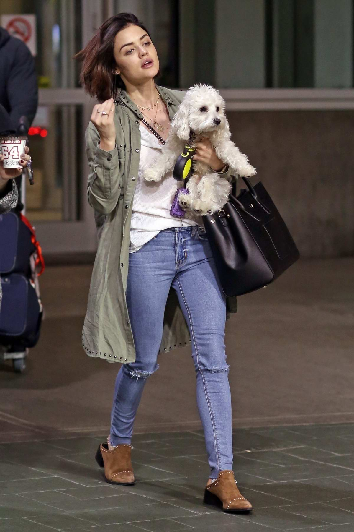 Lucy Hale gets greeted by her dog Elvis while arriving back into Vancouver, Canada