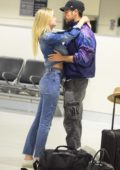 Megan Blake Irwin shares a kiss with boyfriend Nicolo Knows, as they wait for their luggage at the Airport in Sydney