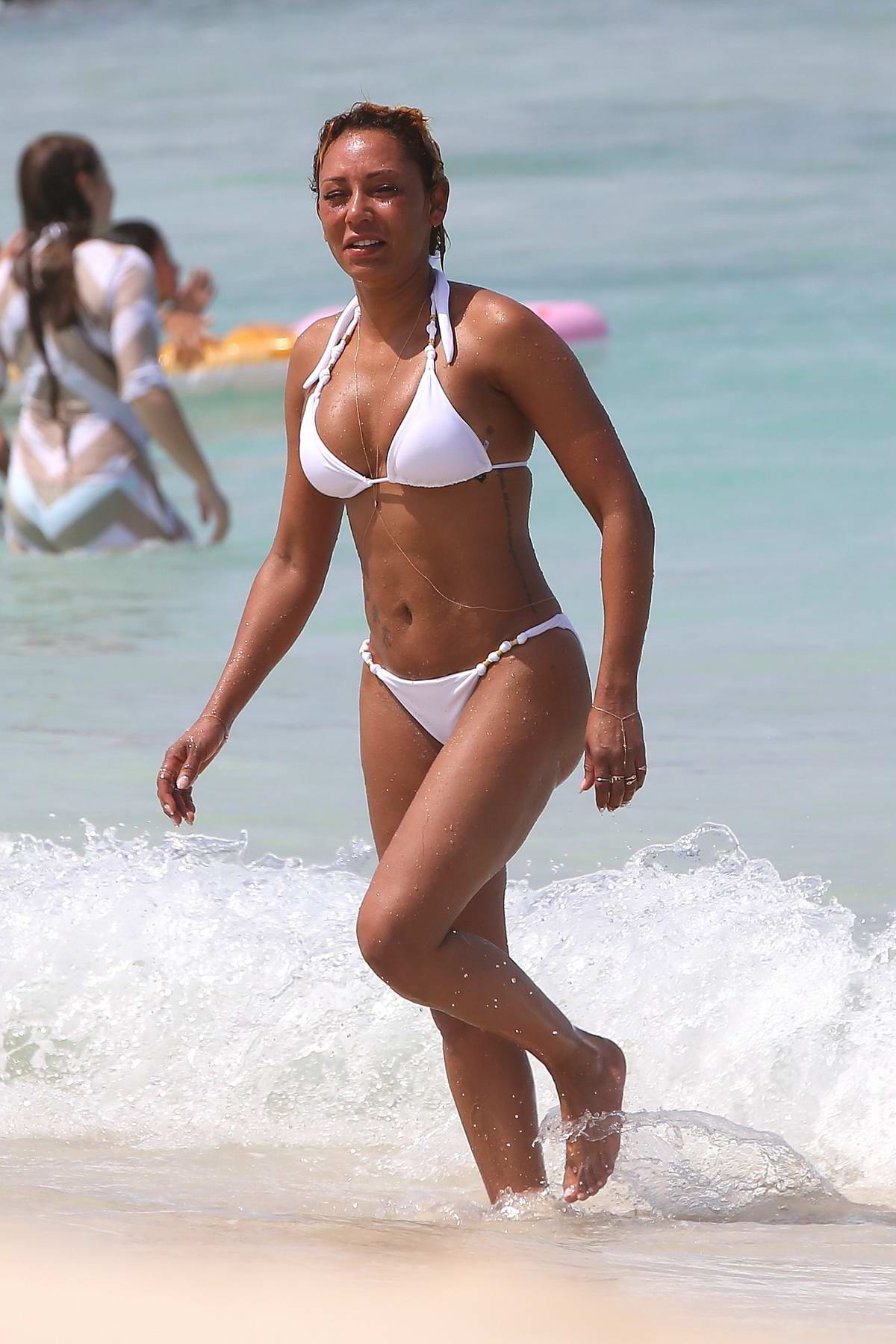 Melanie Brown in a white bikini spotted on a yacht in Hawaii