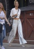 Michaela Kocianova wearing an all white ensemble while out shopping with friends in SoHo, New York City