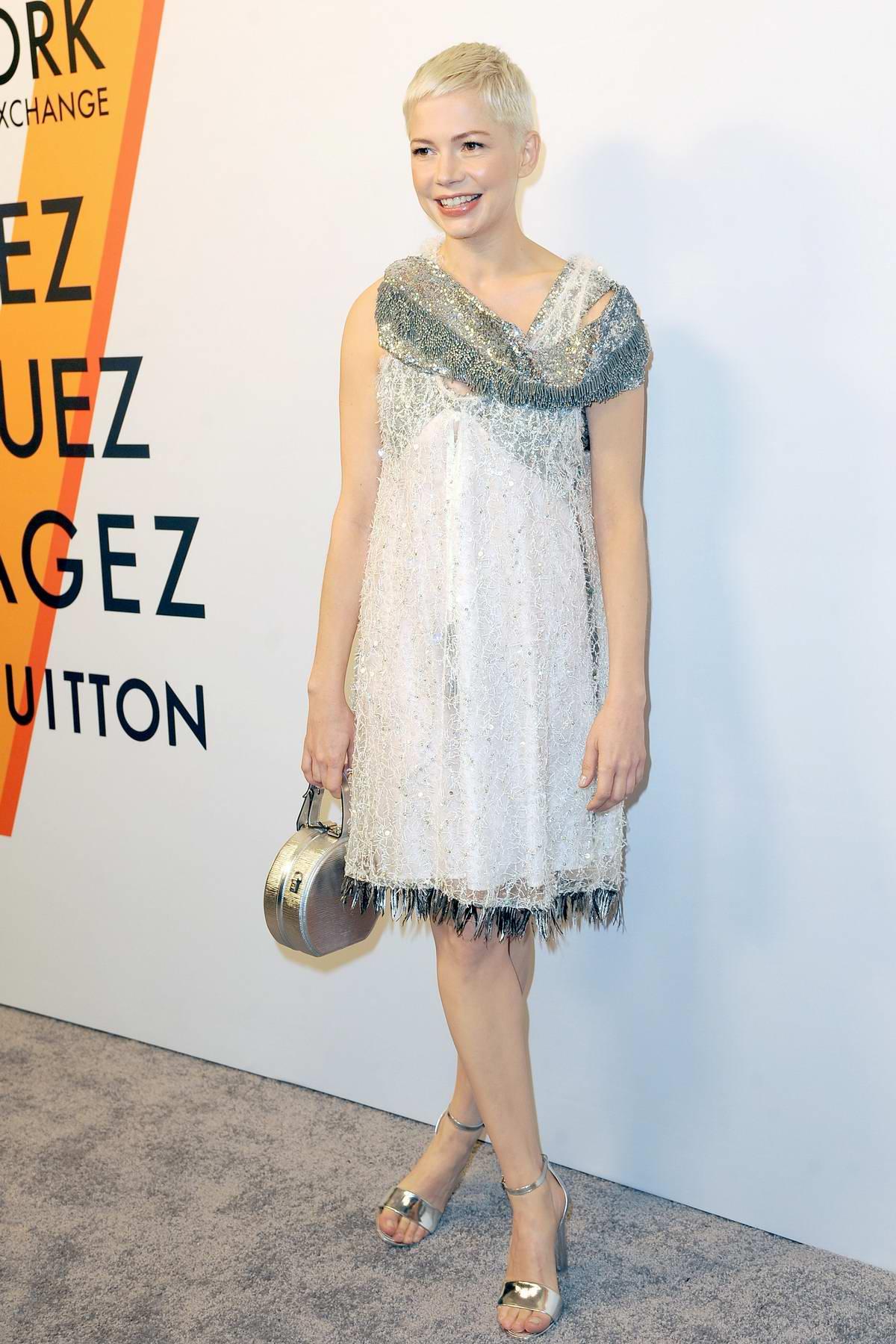 Michelle Williams at Louis Vuitton 'Volez, Voguez, Voyagez' exhibition opening in New York