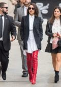 Mila Kunis is seen arriving at Jimmy Kimmel Live wearing long red boots in Los Angeles