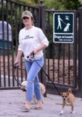 Minka Kelly sports a white sweater with jeans as she is seen enjoying time with her dogs at the park in Los Angeles