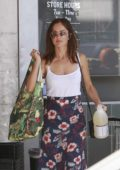 Minka Kelly wears a floral skirt and a white top while doing some groceries shopping at Whole Foods in West Hollywood, Los Angeles
