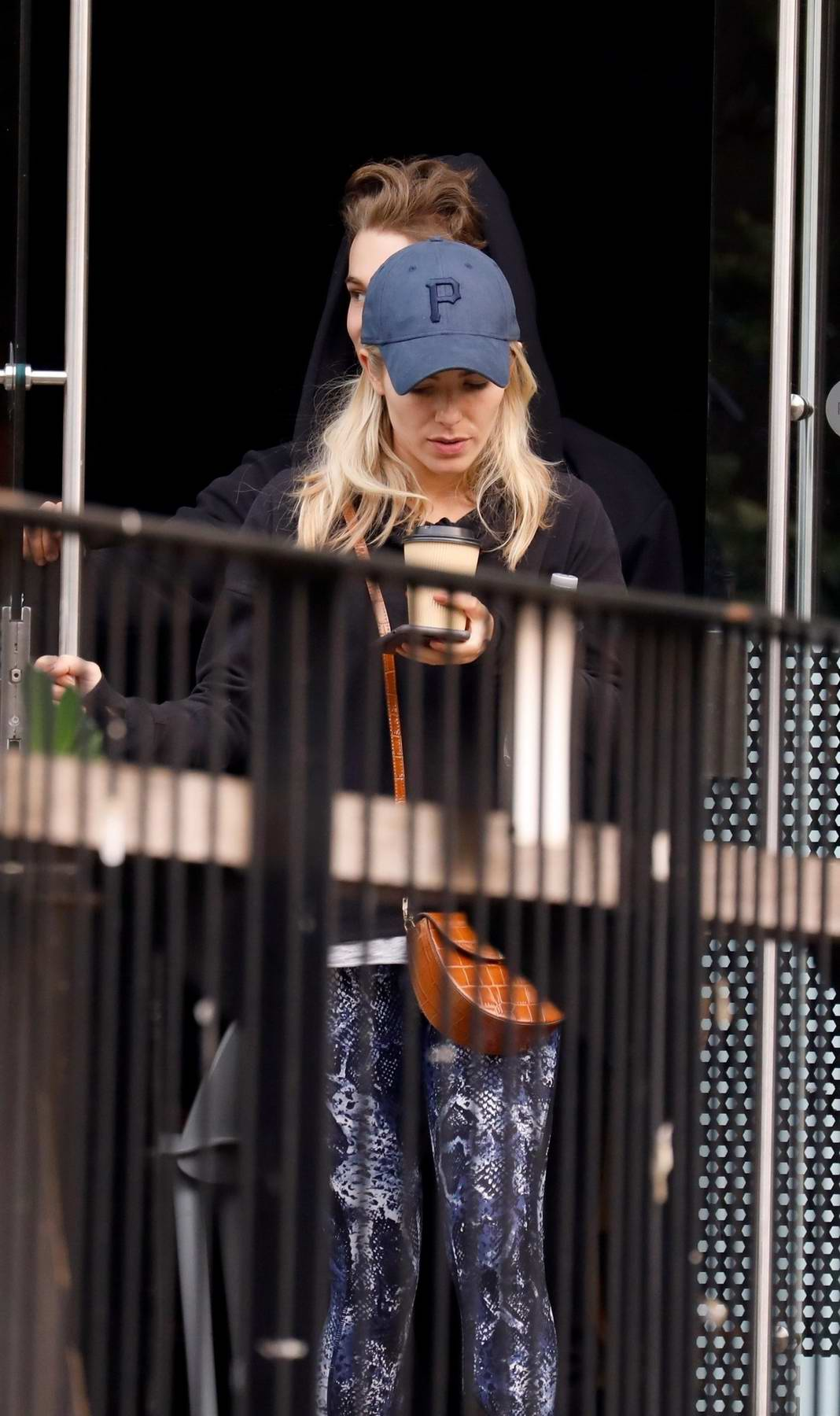 Mollie King and AJ Pritchard grab a hot drink while taking a break from their rehearsals in London