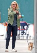 Naomi Watts is spotted out for a morning walk with her dogs in New York