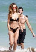 Natalia Borges in a black bikini at the beach in Miami, Florida