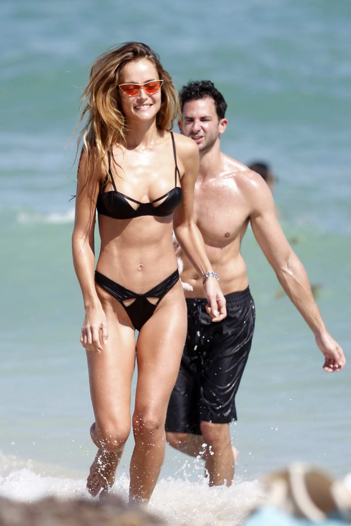 Natalia Borges in a black bikini at the beach in Miami, Florida