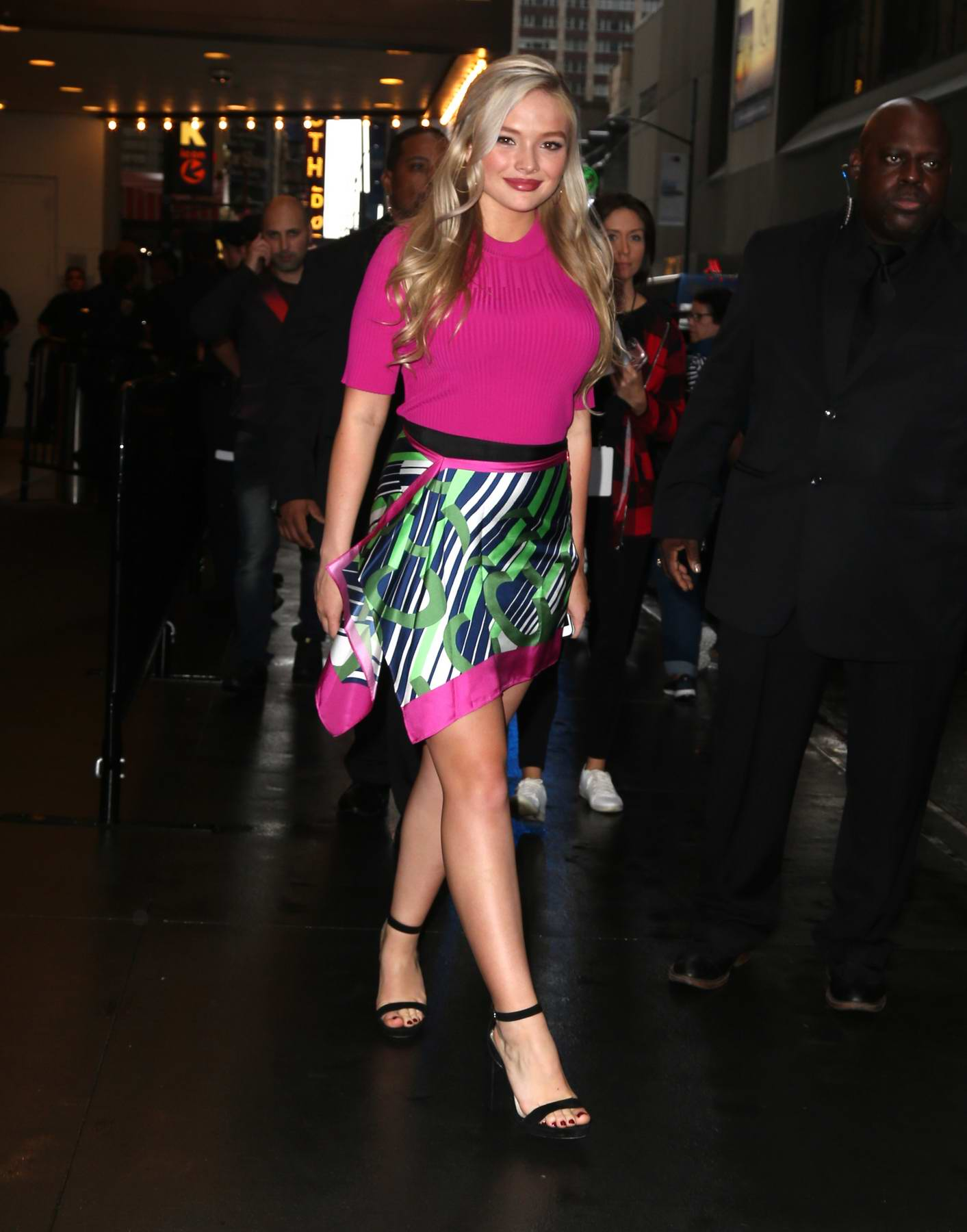 Natalie Alyn Lind in a pink dress arrives at Total Request Live (TRL) in New York City