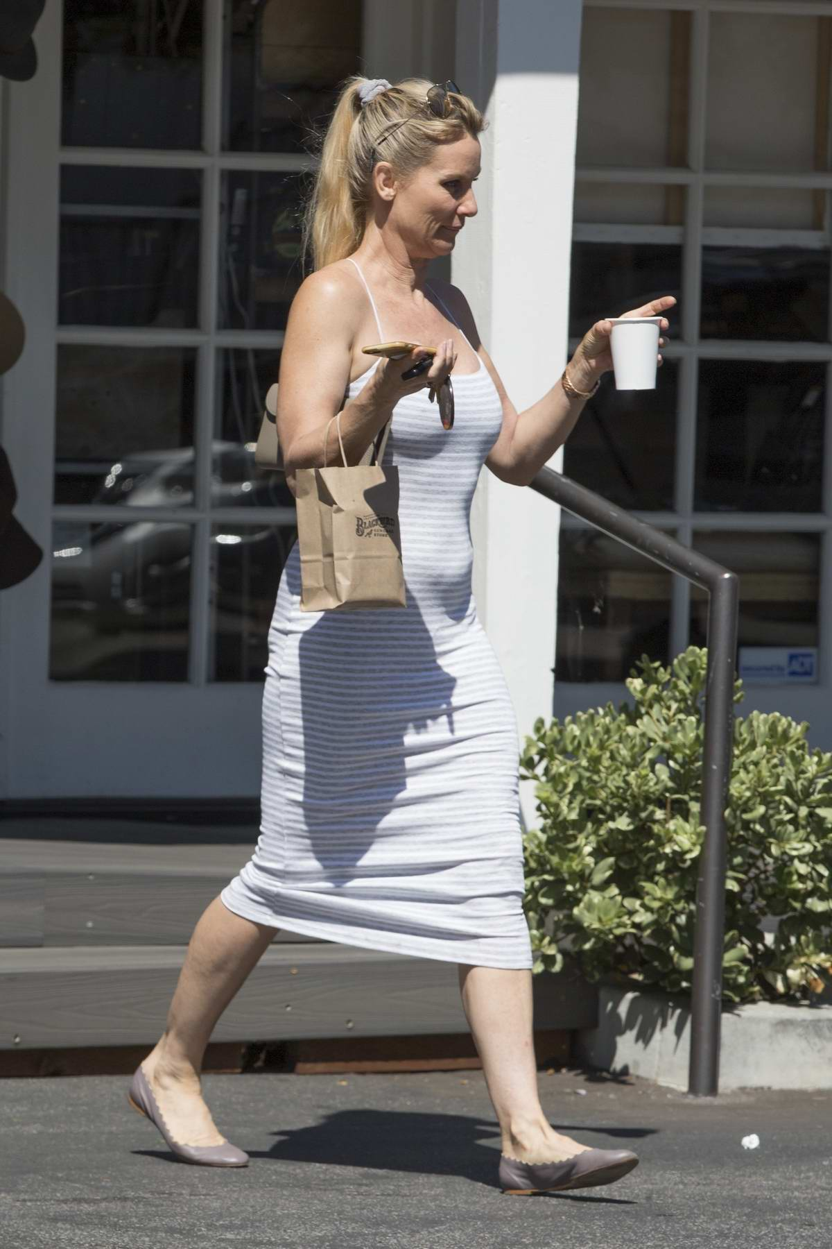 Nicollette Sheridan spotted picking up a cup of coffee in Calabasas, California