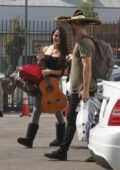 Nikki Bella and her partner Artem Chigvintsev heads to their dance practice while carrying some props in Los Angeles