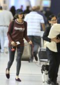 Nina Dobrev is accompanied by her dog at Toronto Airport, Canada